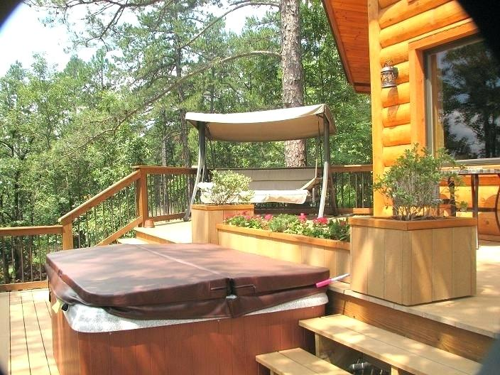 Enjoy the private back deck with hot tub and swing under the stars