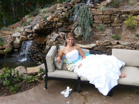 bride in front of waterfall in Little Rock wedding location